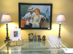 Check-in table at Art Uncorked. Painting and print by Summer Lowe Russell