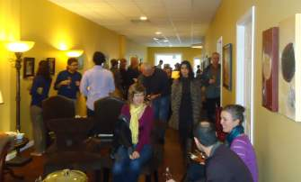 Crowd enjoying art and wine