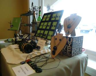 Display of jewelry and wine accessories from Eco Glass Studios.